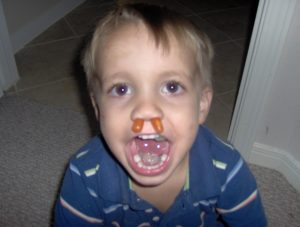 little boy with candy in his nose